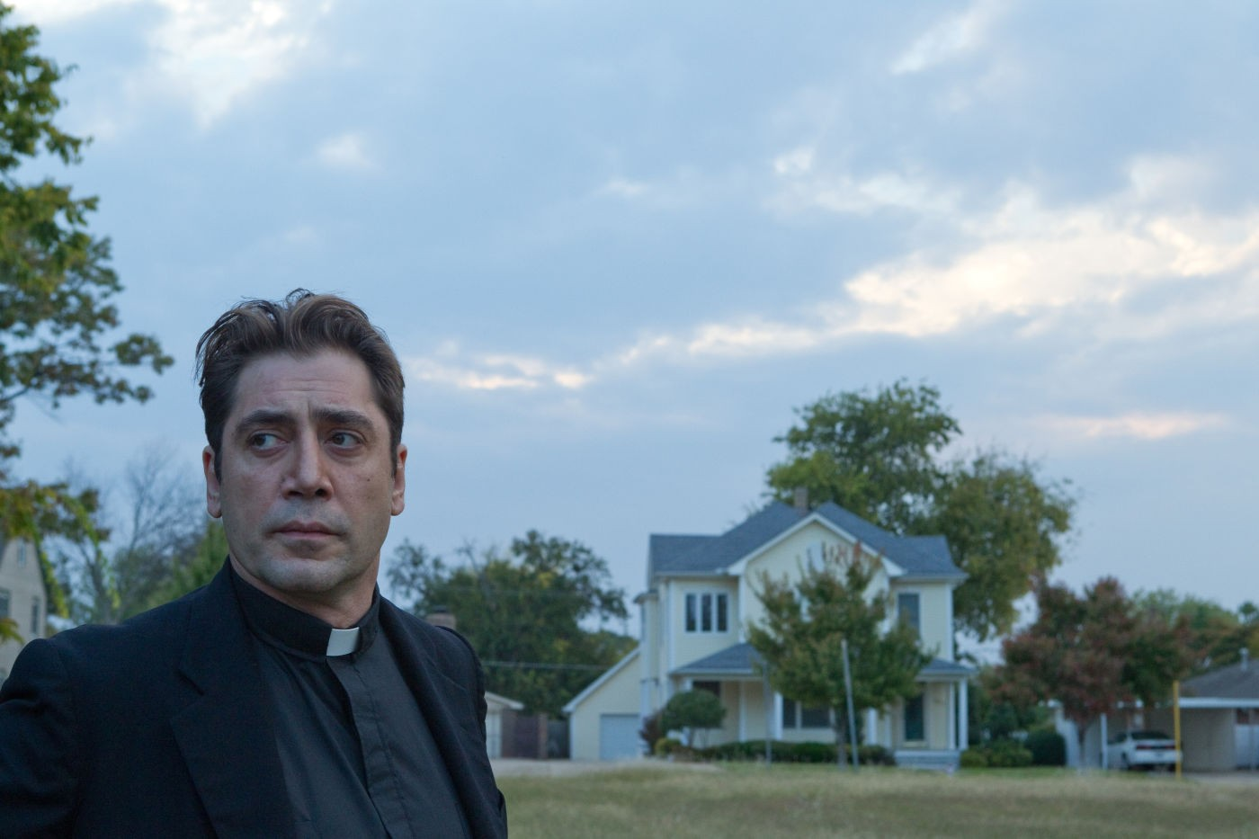 Javier Bardem as a priest